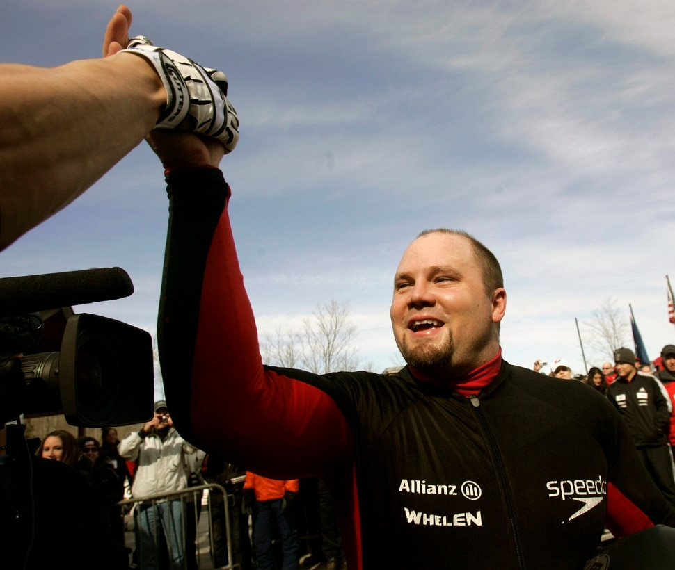 American driver Steven Holcomb celebrates his team's win at the men's Bobsled World Championships in Lake Placid, N.Y., Sunday, March 1, 2009. (AP Photo/Mike Groll)