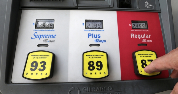 In this Tuesday, May 2, 2017, photo, a motorist prepares to select regular gas at a pump at a Chevron station in Miami. Gas prices are still quite low, historically speaking, and were fairly steady in 2017. But 2018 may be a bit more rocky, according to Tom Kloza, global head of energy analysis at the Oil Price Information Service. (AP Photo/Alan Diaz)