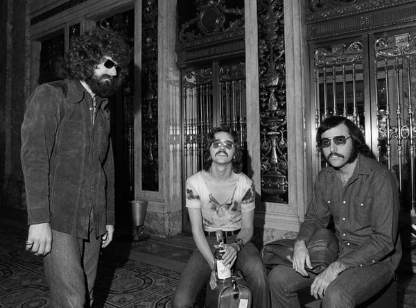 (Marty Lederhandler | AP file photo) Members of the rock band Steppenwolf are seen, Aug. 25, 1970. Outside the Plaza Hotel in New York, from left to right: Goldy McJohn, Rushton Moreve and Jerry Edmonton.