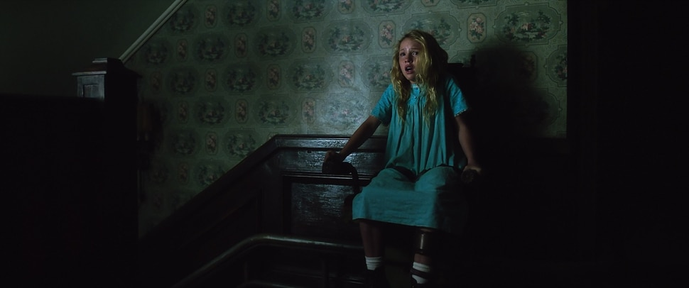 ( ! Warner Bros. Pictures) Polio-stricken Janice (Talitha Bateman) uses a star lift in the house recently donated to her orphanage, but discovers something sinister upstairs, in