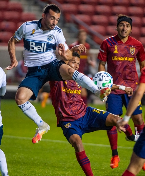 (Rick Egan | The Salt Lake Tribune) Vancouver Whitecaps midfielder Russell Teibert (31) collides with Real Salt Lake midfielder Maikel Chang (16), in MLS soccer action between Real Salt Lake and the Vancouver Whitecaps at Rio Tinto Stadium on Saturday, Sept. 19, 2020.