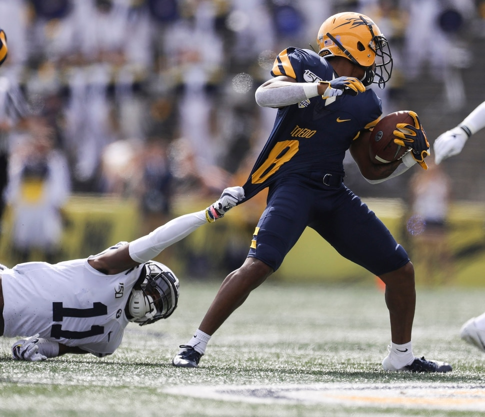 BYU defensive back Isaiah Herron (11) pulls at University of Toledo Devin Maddox (8) jersey during a college football game at the Glass Bowl in Toledo, Ohio on Saturday September 28, 2019. UT defeated BYU 28-21. (Rebecca Benson/The Blade via AP)