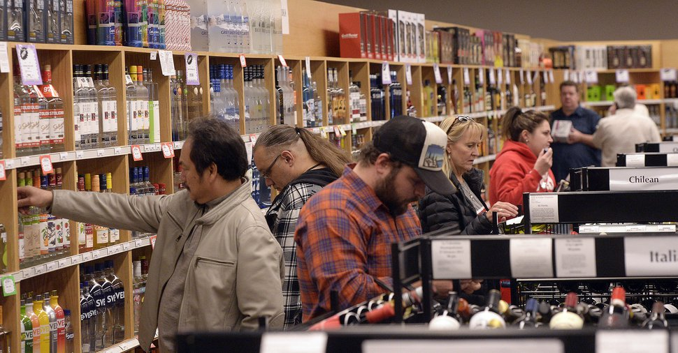 (Al Hartmann | The Salt Lake Tribune) Shoppers fill the aisles at the Cottonwood Heights state liquor store Wednesday, Nov. 22, 2017. The Wednesday before Thanksgiving is one of the busiest days for liquor sales in Utah. Customers typically line up outside before the 11 a.m. opening. Extra employees work to handle the holiday rush.
