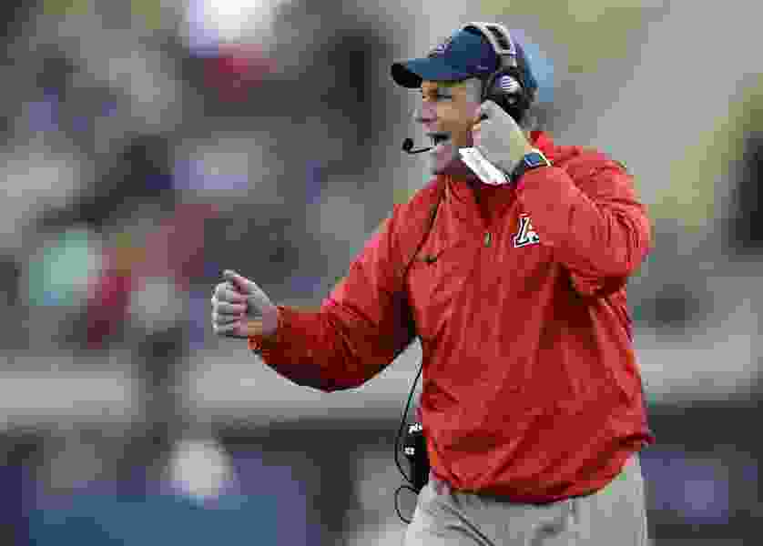 Ex-assistant to fired Arizona coach Rich Rodriguez wants $7.5 million