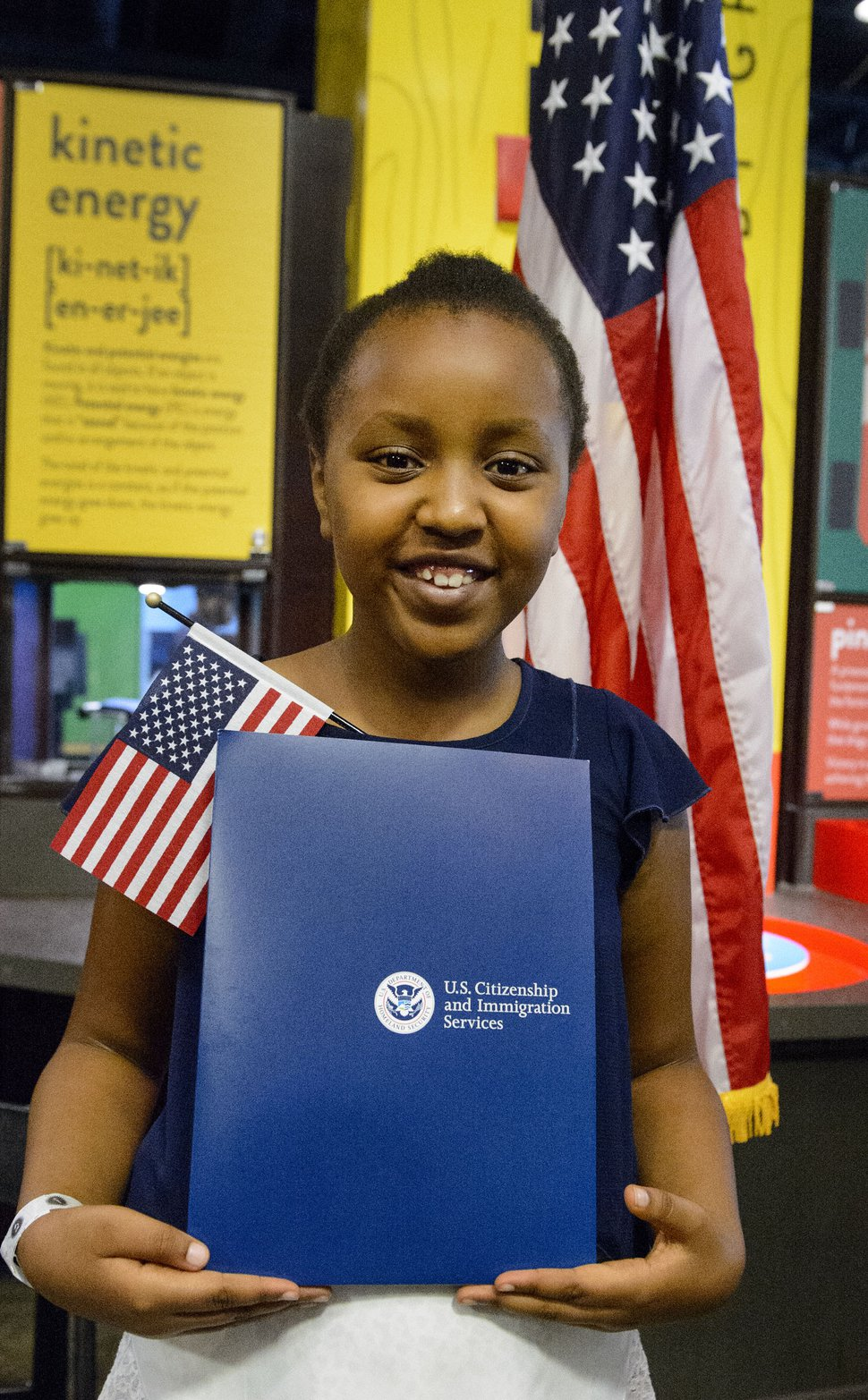 (Steve Griffin | The Salt Lake Tribune) Yguette Umutesi, age 9, smiles as she gets her picture taken as children, ages 7 to 14, had a very special day at Discovery Gateway: the ChildrenÕs Museum of Utah Monday when they received citizenship certificates from the Salt Lake County and U.S. Citizenship and Immigration Services during the ceremony in Salt Lake City Monday August 7, 2017.