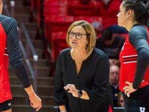 (Rick Egan  |  The Salt Lake Tribune)        Utah Head Coach, Beth Launiere gives instructions to her team, in volleyball action between Utah and BYU, at the Jon M. Huntsman Center, Thursday, Sept. 19, 2019.
