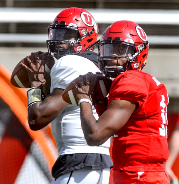(Steve Griffin | The Salt Lake Tribune) Utah quarterbacks Tyler Huntley and Jason Shelley warm-up during the University of Utah football team's first scrimmage at Rice-Eccles Stadium in Salt Lake City Friday March 30, 2018.