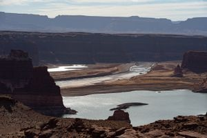 (Francisco Kjolseth  | The Salt Lake Tribune) The Colorado River flows into Lake Powell near Hite Marina on Thursday, Feb. 4, 2021. The reservoir is only 40% full and continued surging demand combined with the ravages of a drying climate signal a water crisis in the not-too-distant future. Wall Street investors see the an opportunity to capitalize on a whole new commodities trading market.