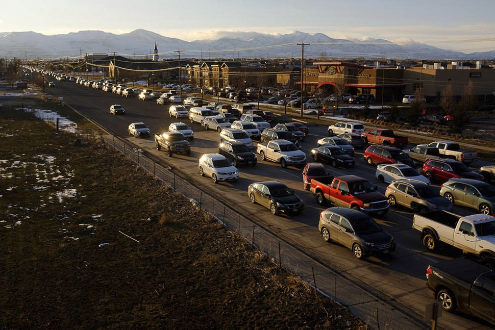 In this Friday Feb. 22, 2019 photo, Rush hour traffic heading west is backed up on 12600 South at Bangerter Highway in Riverton, Utah. Mayors in southwest Salt Lake County say that area is in a transportation crisis, as major east-west roads serving the area are overwhelmed with traffic at rush hour. (Trent Nelson/The Salt Lake Tribune via AP)