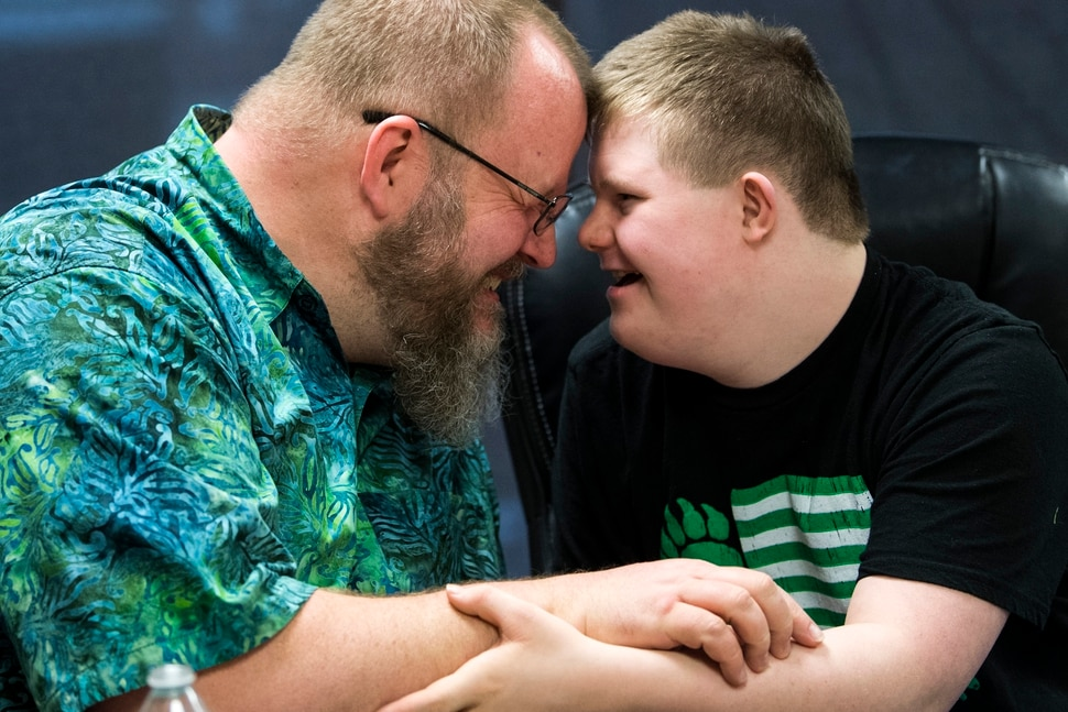 (Chris Detrick | The Salt Lake Tribune) Chad Blythe and his son Logan, 15, embrace during an interview at VF Law in Salt Lake City Friday, March 16, 2018.