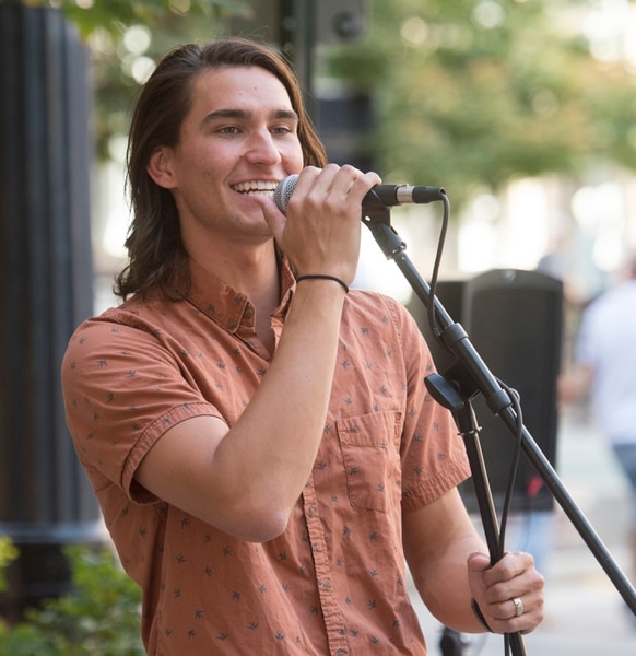 (Rick Egan | The Salt Lake Tribune) Dallin Mcallister performs on Main Street in Salt Lake City. The first Salt Lake Busker Festival is set for Aug. 24 on Regent Street, bringing together street musicians, magicians, jugglers and other performers. Thursday, Aug. 16, 2018.