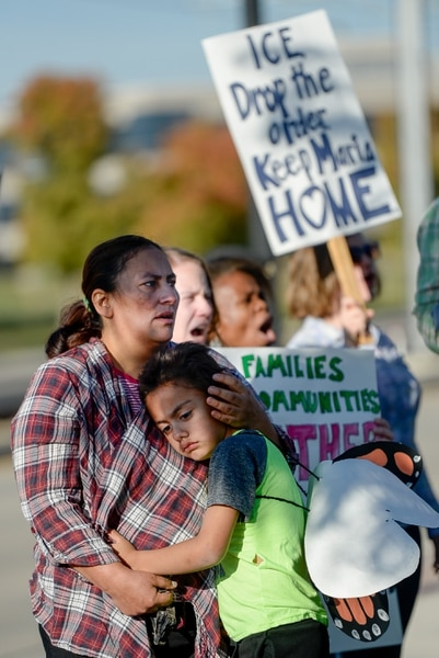 (Francisco Kjolseth | The Salt Lake Tribune) Maria Santiago Garcia is embraced by her son Anthony Fajardo, 5, as community members rally in front of the Immigration and Customs Enforcement offices in West Valley City on Monday, Oct. 16, 2017, to support her. The single Utah mother of four U.S. born children faces an impending deportation order.