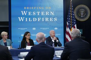 (Susan Walsh   AP) President Joe Biden, right, speaks during an event in the South Court Auditorium on the White House complex in Washington, Wednesday, June 30, 2021, with cabinet officials and governors from Western states to discuss drought and wildfires. Joining him is Energy Secretary Jennifer Granholm, left, and Interior Secretary Deb Haaland, center.