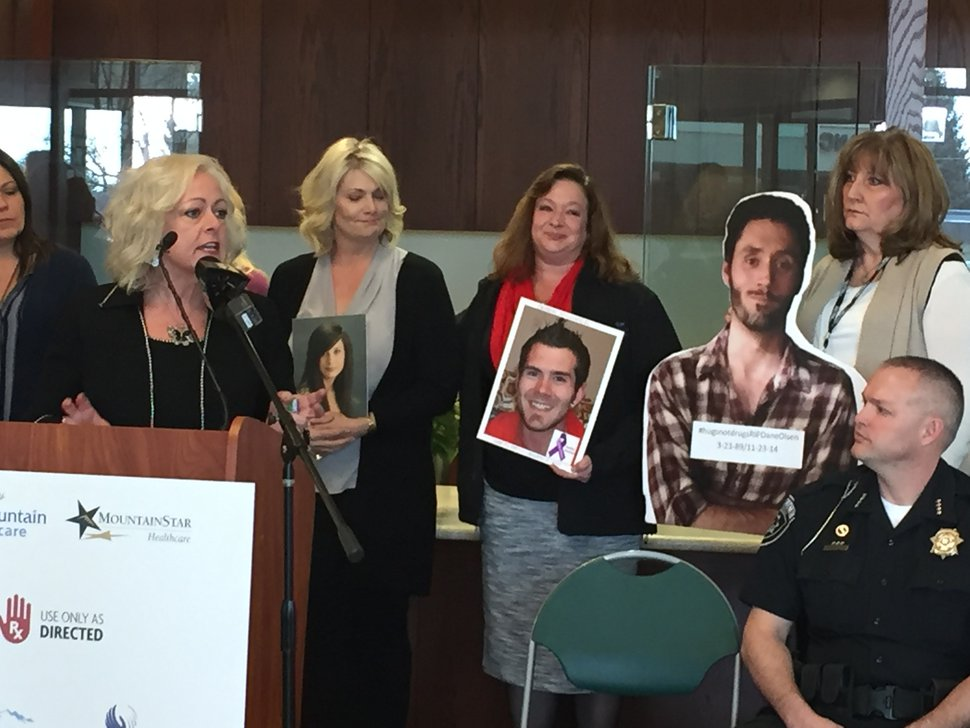 (Luke Ramseth | The Salt Lake Tribune) Heather Lewis, a manager with the Utah County Department of Drug and Alcohol Prevention and Treatment, describes an opioid public awareness effort Thursday at Mountain View Hospital in Payson. Behind her are several mothers of young people who died after opioid overdoses.