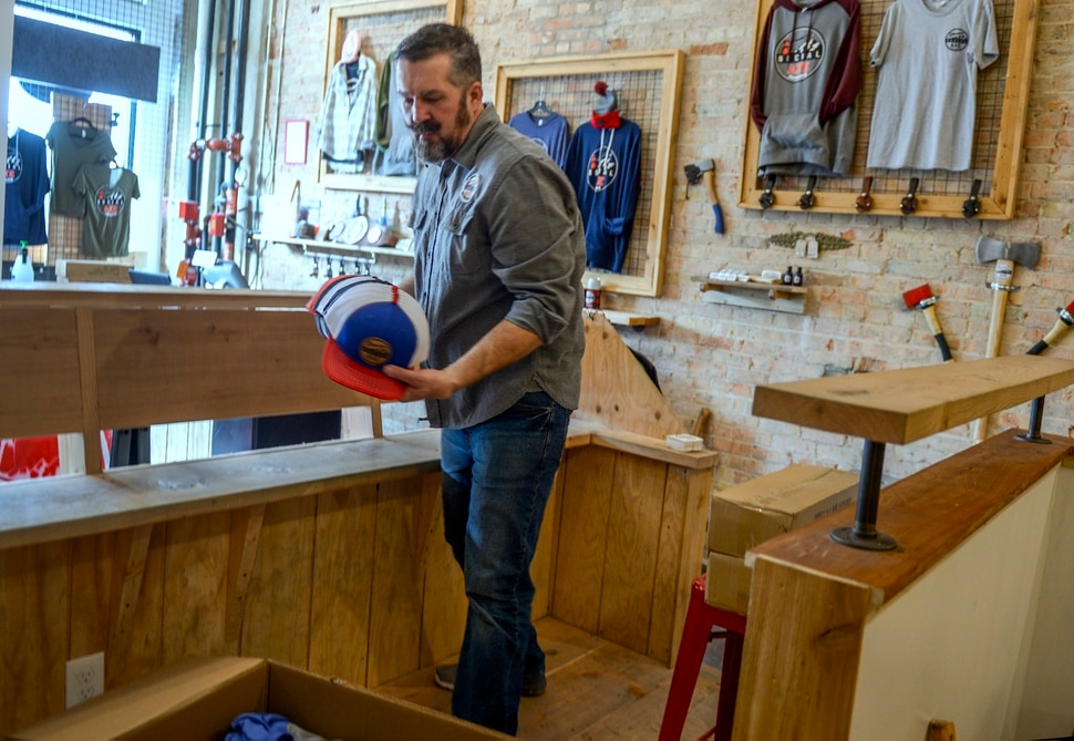 (Leah Hogsten | The Salt Lake Tribune) Social Axe Throwing co-owner Mark Floyd boxes the business's merchandise to take to the Salt Lake location.