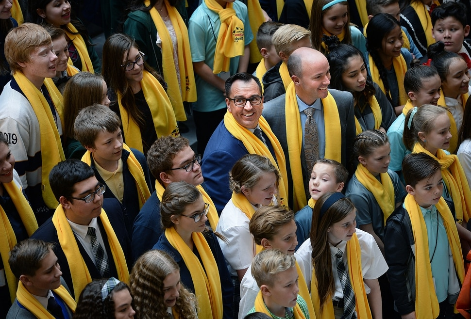 (Scott Sommerdorf | The Salt Lake Tribune) Speaker of the House Greg Hughes, R-Draper, and Lt. Governor Spencer Cox, center, pose for a photo with charter school children during an event in the Capitol rotunda, Thursday, January 25, 2018.