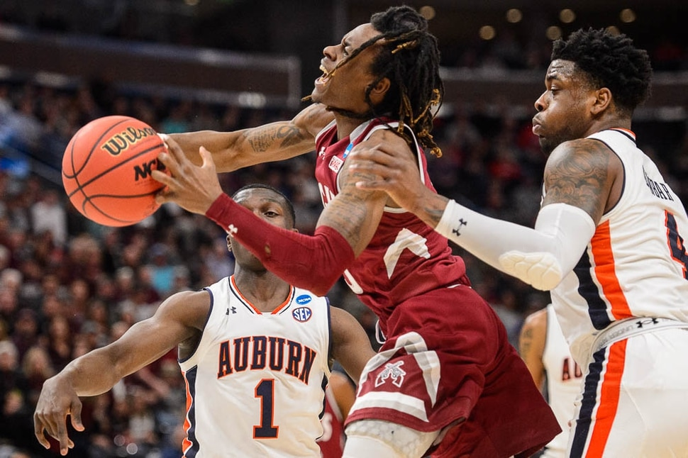 (Trent Nelson | The Salt Lake Tribune) New Mexico State Aggies guard Terrell Brown (3) defended by Auburn Tigers guard Jared Harper (1) and Auburn Tigers guard Malik Dunbar (4) as Auburn faces New Mexico State in the 2019 NCAA Tournament in Salt Lake City on Thursday March 21, 2019.