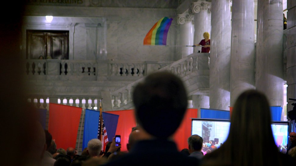 (Photo courtesy of Blue Fox Entertainment) A supporter of gay rights flies a rainbow flag over a rally for