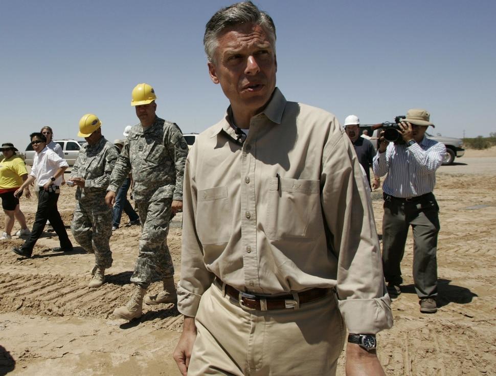 (Jim Urquhart | Tribune file photo) Gov. Jon Huntsman tours a Utah National Guard construction site at the U.S.-Mexico border of Arizona in 2006.