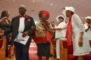 (Leah Hogsten  |  The Salt Lake Tribune) The Rev. France A. Davis and his wife Willene, celebrated Davis' 44th anniversary as pastor at Calvary Baptist Church. The two are greeted and congratulated by members of the congregation, Sunday, April 22, 2018, as they enter the nave. Davis, who arrived in Salt Lake City in 1974, has built the African-American congregation to more than 700 members.