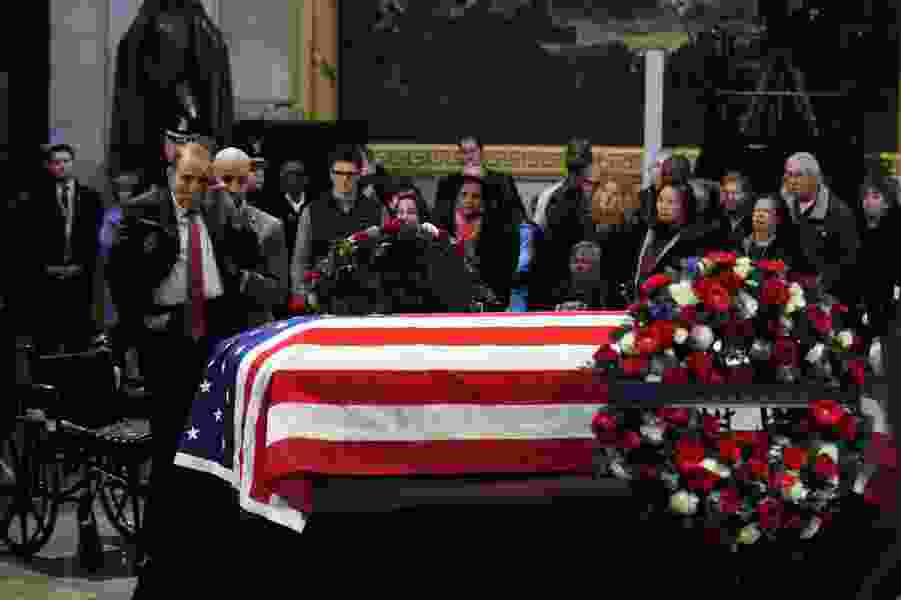 Bob Dole, federal workers and CIA directors join crowds paying their respects to Bush