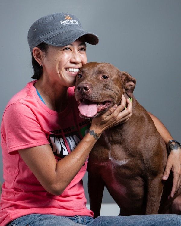 (Courtesy Chris Dickinson | Chris Dickinson Photography) Playwright and dog trainer Jenifer Nii, with Cora, her rescue dog, a pit bull.