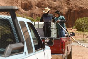 (Leah Hogsten | Tribune file photo) Two young boys fill the family water tank at the Oljato-Monument Valley water spigot adjacent to the post office on June 22, 2020. The water well is one of a few locations in San Juan County where members of the Navajo Nation can get clean water. More than one-third of Navajo Nation households lack running water, and the problem is even worse in San Juan County where over 40% of Navajo Nation residents have to haul water. Families fill jugs at communal wells or buy bottled water from stores — both costly and time-consuming burdens that have become only more difficult during the pandemic and the tribe's daily and weekend curfews.