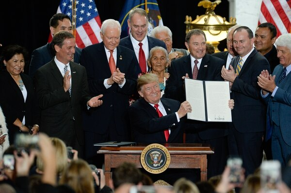 (Francisco Kjolseth | The Salt Lake Tribune) U.S. President Donald Trump is surrounded by Utah representatives at the Utah Capitol on Monday, Dec. 4, 2017, as he signs two presidential proclamations to shrink Bears Ears and Grand Staircase-Escalante national monuments.