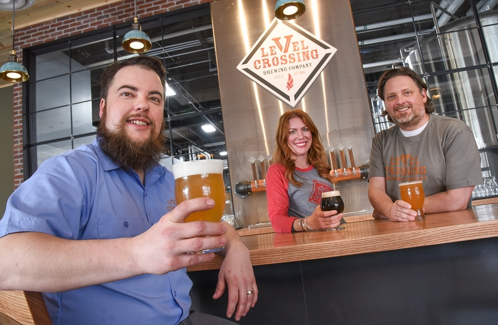 (Francisco Kjolseth | The Salt Lake Tribune) Level Crossing Brewing Co.'s team includes head brewer, Chris Detrick, left, Katie Flanagan, sales and marketing manager and Mark Medura, owner.