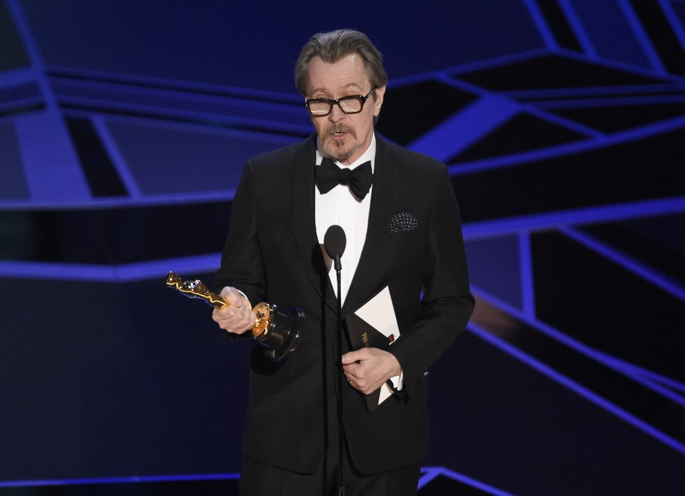 Gary Oldman accepts the award for best performance by an actor in a leading role for