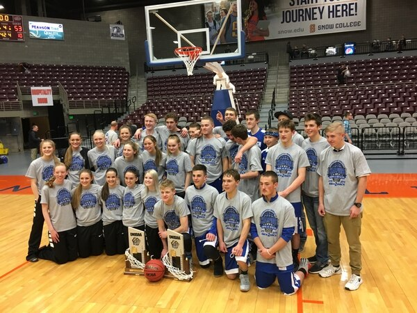 Tom Wharton | For The Tribune The Panguitch boys' and girls' basketball teams pose for a photo after both won the Class 1A state championships Saturday in Richfield.
