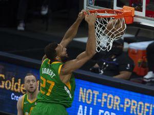 Utah Jazz center Rudy Gobert (27) dunks the ball against the Sacramento Kings during the first quarter of an NBA basketball game in Sacramento, Calif., Sunday, May 16, 2021. (AP Photo/Randall Benton)