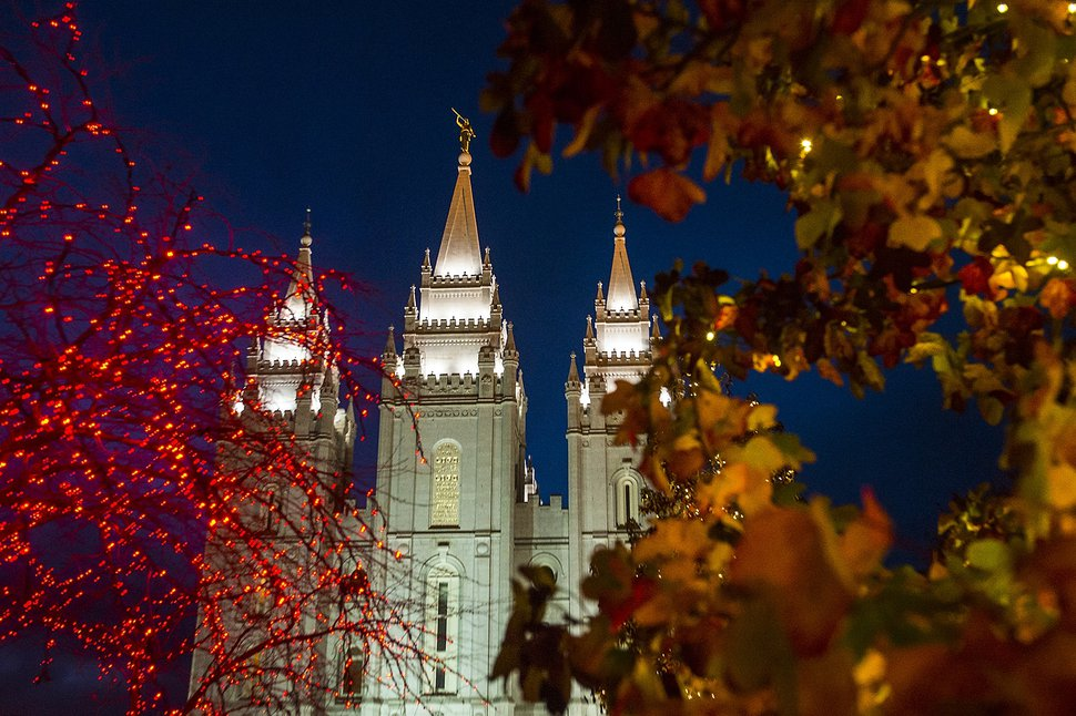 (Chris Detrick | The Salt Lake Tribune) Visitors look at Christmas lights on Temple Square on Friday, Nov. 24, 2017.