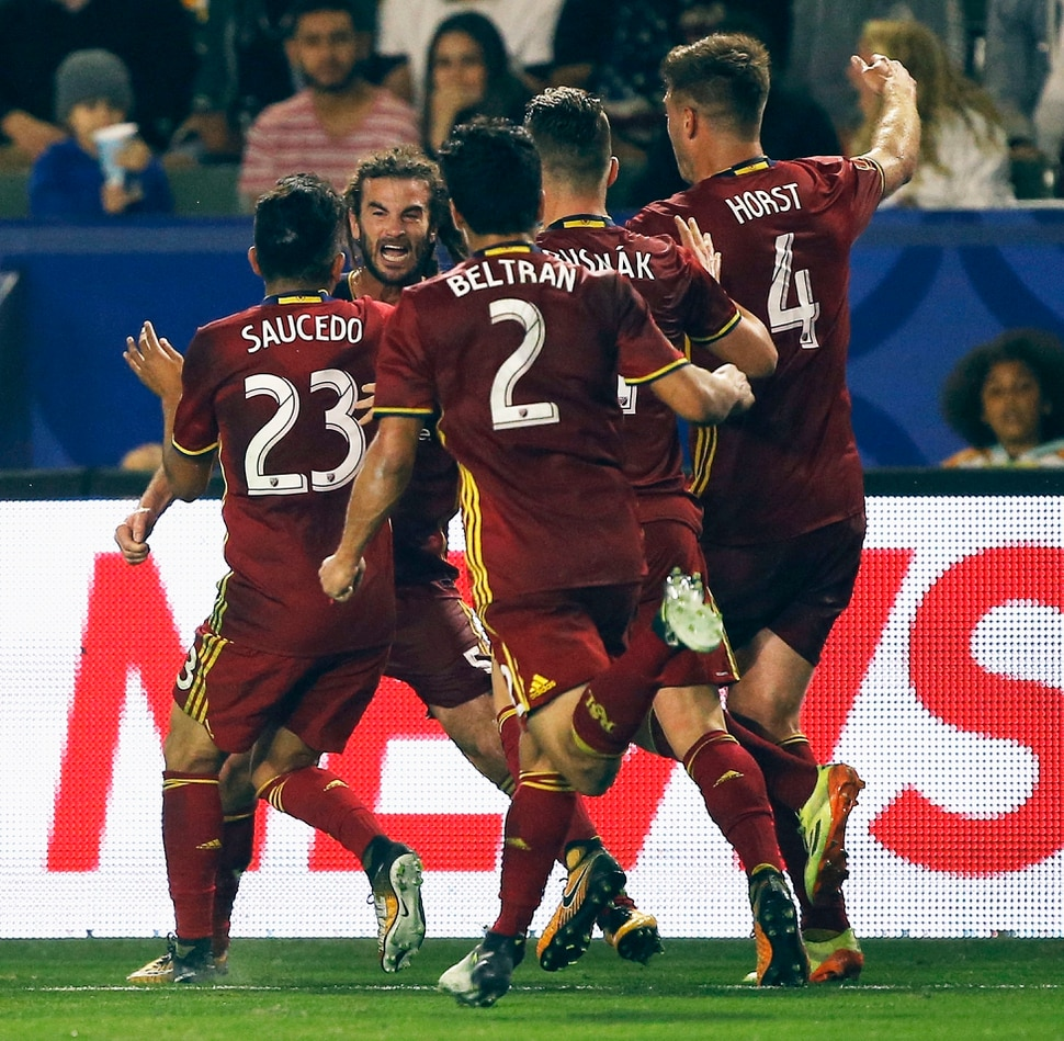 Real Salt Lake midfielder Kyle Beckerman, second from left, celebrates with midfielder Sebastian Saucedo (23), defender Tony Beltran (2), midfielder Albert Rusnak, second from right, and defender David Horst (4) after scoring a goal during the second half of an MLS soccer game against the Los Angeles Galaxy in game in Carson, Calif., Saturday, Sept. 30, 2017. The match ended in a tie. (AP Photo/Alex Gallardo)
