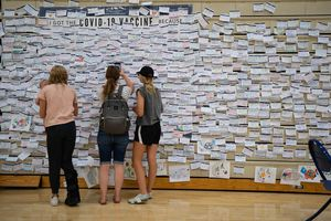 (Francisco Kjolseth   The Salt Lake Tribune) Folded up bleachers at the old Provo High School gym are covered in notes accumulated since April by people giving their reasons for getting the COVID-19 vaccine as health care representatives administer the vaccine nearby on Wednesday, July 28, 2021.