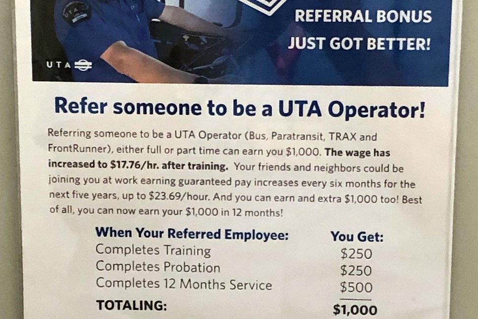(Lee Davidson | The Salt Lake Tribune) Poster on the inside of a bathroom stall door at Utah Transit Authority headquarters offers employees up to $1,000 if they refer a friend who is hired as a bus driver.
