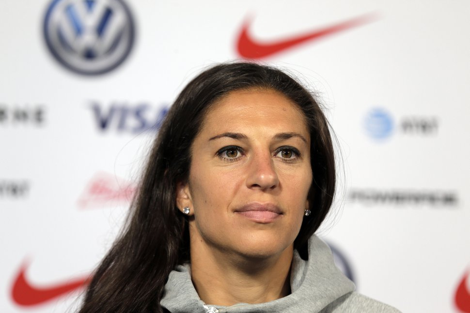 Carli Lloyd, a member of the United States women's national soccer team, speaks to reporters during a news conference in New York, Friday, May 24, 2019. (AP Photo/Seth Wenig)