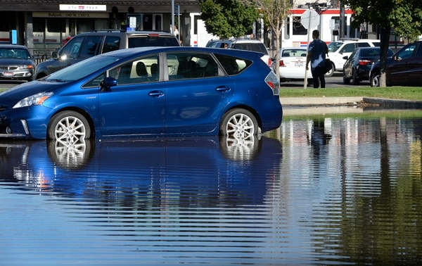 Scott Sommerdorf | The Salt Lake Tribune The flooded parking lot at the Ballpark Station. Northbound Main Line TRAX trains were prevented from leaving the station due to flooding, Wednesday, July 26, 2017. Northbound riders were taken via a bus bridge to the next station.