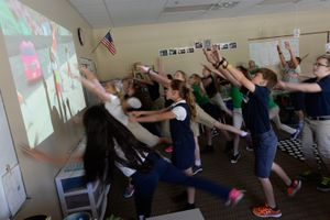 """(Francisco Kjolseth    Tribune file photo) In this 2016 file photo, 5th grade students take a short """"Brain Break,"""" at Ascent Academy in Farmington dance and sing along to a video on the screen."""
