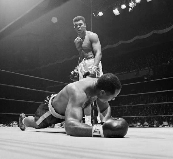 FILE - In this March 22, 1967, file photo, champion Muhammad Ali stands over, Zora Folley during their heavyweight title fight in New York's Madison Square Garden. Ali's final fight in the ring before taking on the government was at Madison Square Garden, where he punished Folley before stopping him in the seventh round to remain unbeaten. (AP Photo/File)