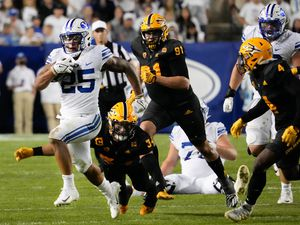 (Francisco Kjolseth | The Salt Lake Tribune) Brigham Young Cougars running back Tyler Allgeier (25) carries the ball against the Arizona State Sun Devils at LaVell Edwards Stadium in Provo, on Saturday, Sept. 18, 2021.