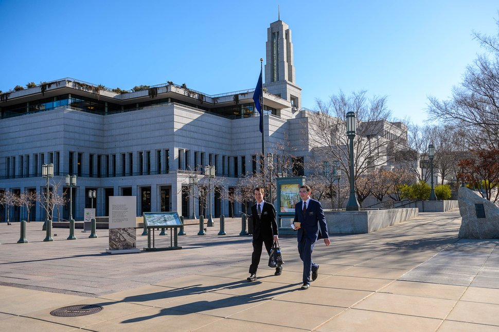 (Trent Nelson | The Salt Lake Tribune) Two missionaries walk past the Conference Center in Salt Lake City just before The Church of Jesus Christ of Latter-day Saints holds General Conference on Saturday, April 4, 2020. The area would usually be packed with tens of thousands of conferencegoers. But because of the coronavirus pandemic, no public attendance is permitted. In fact, the conference is coming from a