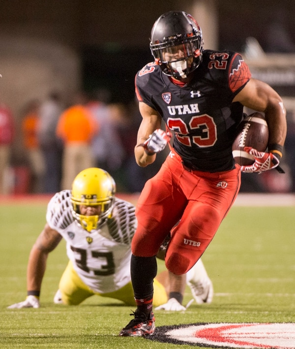 Rick Egan | The Salt Lake Tribune Oregon Ducks linebacker Tyson Coleman (33) watches as Ute running back Devontae Booker (23) runs the ball into the end zone for a touchdown, in Pac-12 football action, Utah vs. Oregon game, at Rice-Eccles Stadium, Saturday, November 8, 2014