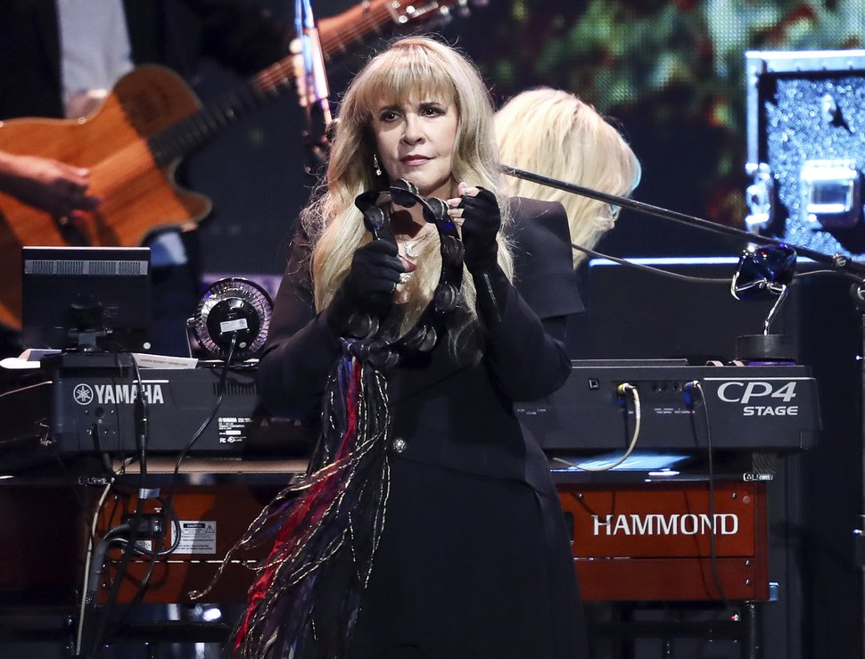 Stevie Nicks of the band Fleetwood Mac performs at the 2018 iHeartRadio Music Festival Day 1 held at T-Mobile Arena on Friday, Sept. 21, 2018, in Las Vegas. Nicks will join Def Leppard, Janet Jackson, Radiohead, the Cure, Roxy Music and the Zombies as new members of the Rock and Roll Hall of Fame. The 34th induction ceremony will take place on March 29 at Barclays Center in New York. (Photo by John Salangsang/Invision/AP)