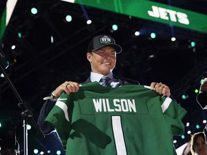 BYU quarterback Zach Wilson holds a New York Jets jersey after being selected second overall in the first round of the NFL football draft Thursday, April 29, 2021, in Cleveland. (AP Photo/Tony Dejak)