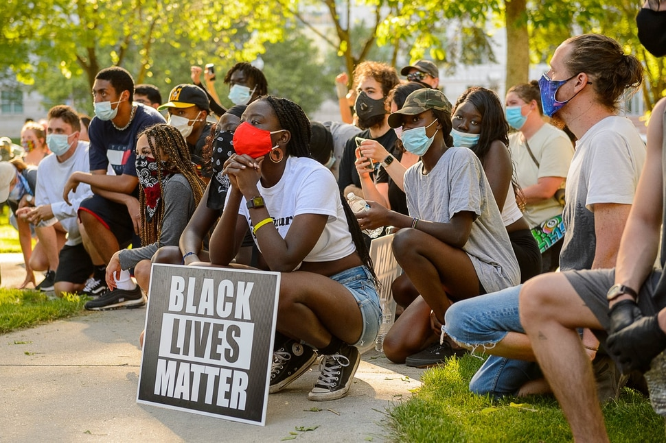 (Trent Nelson | The Salt Lake Tribune) People kneel as the names of people killed by police are read during a protest against police brutality in Salt Lake City on Monday, June 1, 2020.