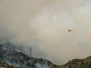 (Trent Nelson | The Salt Lake Tribune)  Helicopters and tankers fight the Dollar Ridge Fire at Strawberry Reservoir, Friday July 6, 2018.