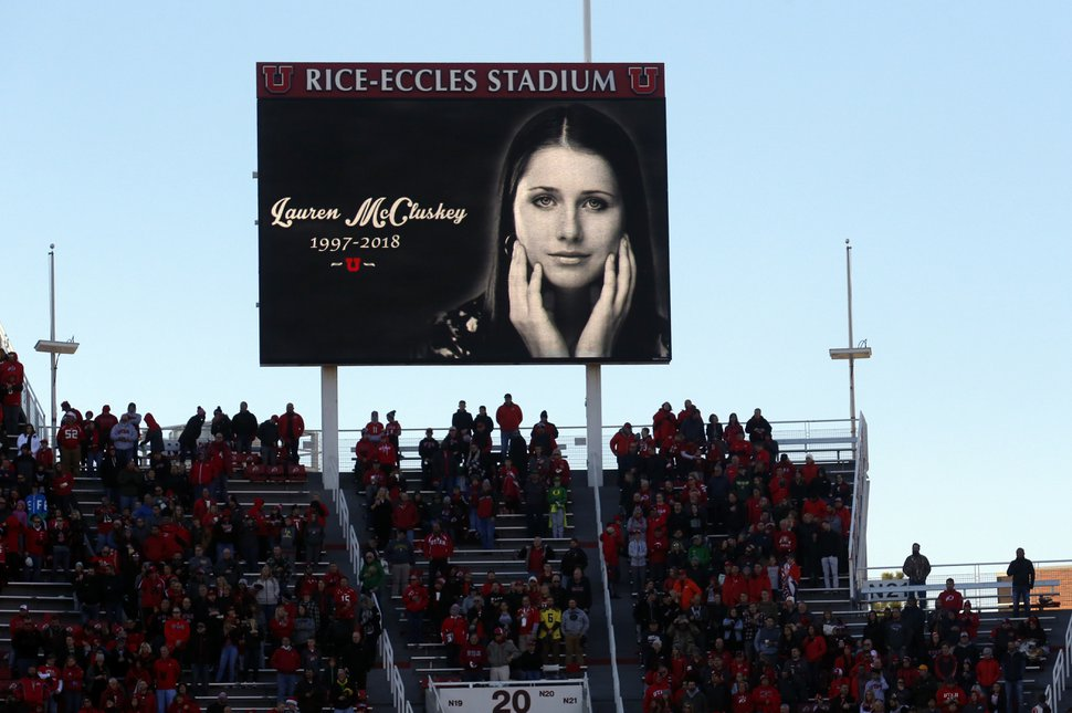 Photo/Rick Bowmer, File) In this Nov. 10, 2018, file photo, a photograph of University of Utah student and track athlete Lauren McCluskey, who was fatally shot on campus, is projected on the video board before the start of an NCAA college football game between Oregon and Utah in Salt Lake City.(AP