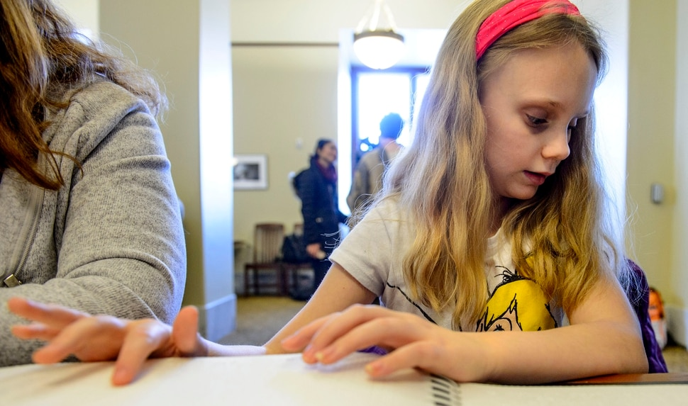 (Steve Griffin | The Salt Lake Tribune) Ellie Mckinlay works on her Braille literacy during the Utah Schools for the Deaf and Blind Kids in the Classroom at the Capitol day in Salt Lake City Thursday February 8, 2018.