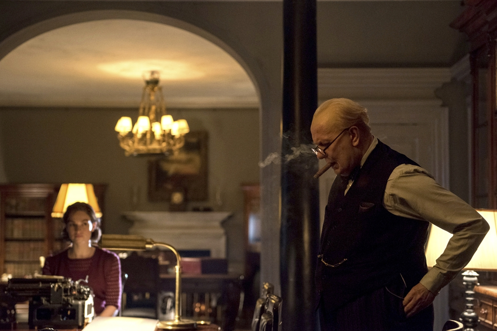 This image released by Focus Features shows Lily James as Elizabeth Layton, left, and Gary Oldman as Winston Churchill in a scene from Darkest Hour. (Jack English/Focus Features via AP)